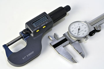 caliper and micrometer tools used by tool and die makers
