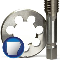 arkansas a metal die and a screw tap, isolated on a white background