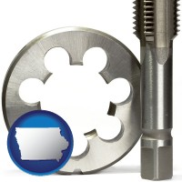 iowa a metal die and a screw tap, isolated on a white background