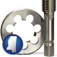 mississippi a metal die and a screw tap, isolated on a white background