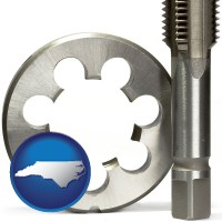 north-carolina map icon and a metal die and a screw tap, isolated on a white background