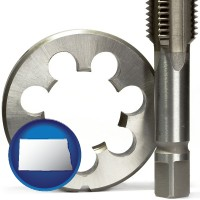 north-dakota map icon and a metal die and a screw tap, isolated on a white background