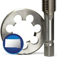 south-dakota map icon and a metal die and a screw tap, isolated on a white background