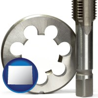 wyoming a metal die and a screw tap, isolated on a white background