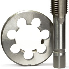 a metal die and a screw tap, isolated on a white background