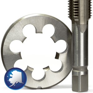 a metal die and a screw tap, isolated on a white background - with Alaska icon