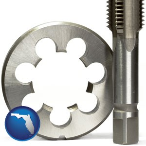 a metal die and a screw tap, isolated on a white background - with Florida icon