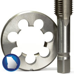 a metal die and a screw tap, isolated on a white background - with Georgia icon