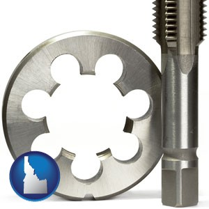a metal die and a screw tap, isolated on a white background - with Idaho icon