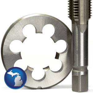 a metal die and a screw tap, isolated on a white background - with Michigan icon