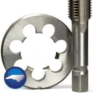 a metal die and a screw tap, isolated on a white background - with North Carolina icon
