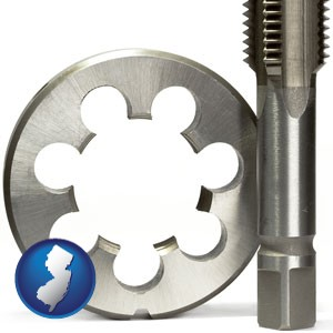 a metal die and a screw tap, isolated on a white background - with New Jersey icon