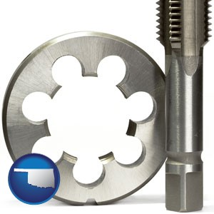 a metal die and a screw tap, isolated on a white background - with Oklahoma icon