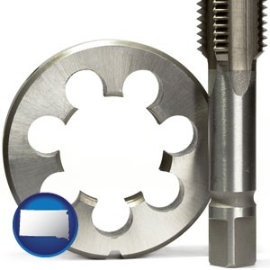 a metal die and a screw tap, isolated on a white background - with South Dakota icon