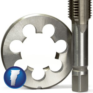 a metal die and a screw tap, isolated on a white background - with Vermont icon