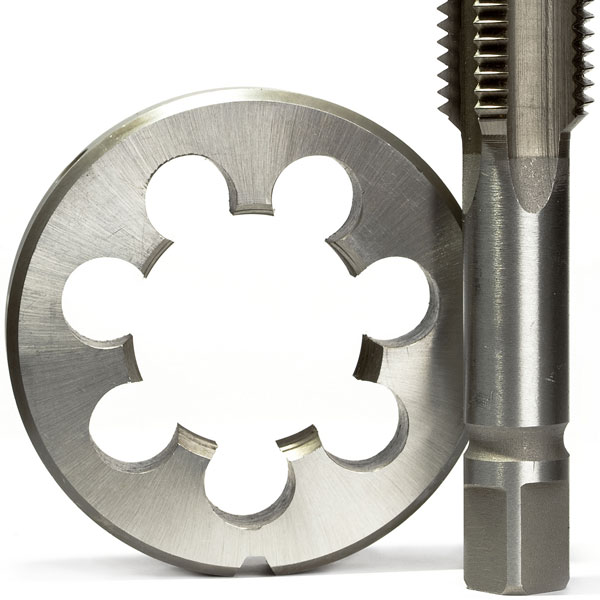 Metal die and a screw tap isolated on a white background